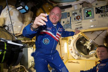 FILE PHOTO: NASA astronaut Scott Kelly is shown with flight engineer Sergey Volkov (R) from the International Space Station in this NASA image released on February 29, 2016. REUTERS/NASA/Handout/File Photo