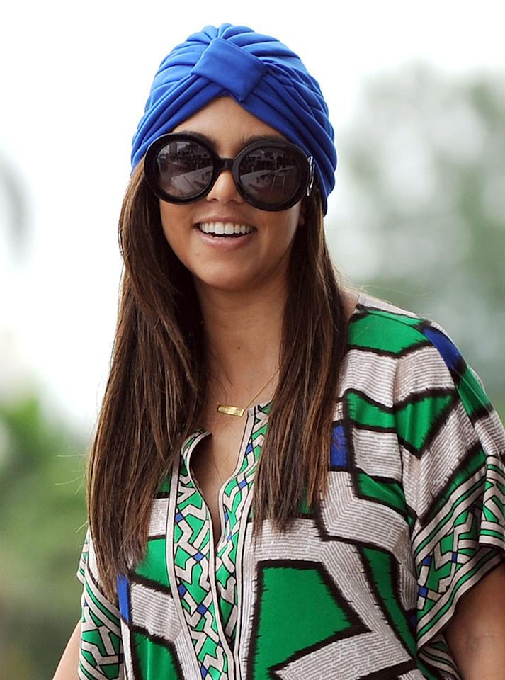 Kim K.'s big sis Kourtney also made a fashion faux pas this week when she stepped out in Miami wearing a bright blue turban. All that was missing from her ensemble was a crystal ball. (9/25/2012)