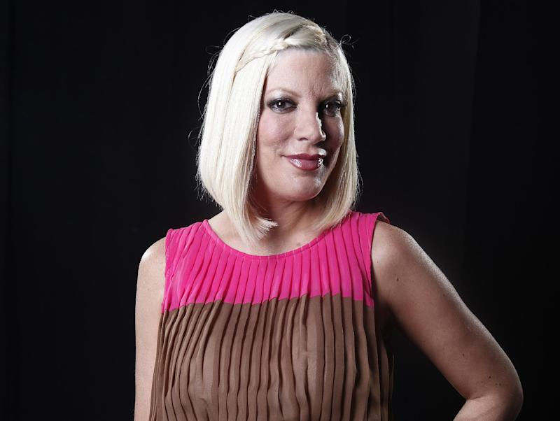 FILE - In this April 3, 2012 file photo, actress Tori Spelling poses for a portrait in New York. Spelling has given birth to her fourth child, a son named Finn. The actress announced on Thursday, Aug. 30, 2012, the birth on her official website and Twitter account. (AP Photo/Carlo Allegri, File)