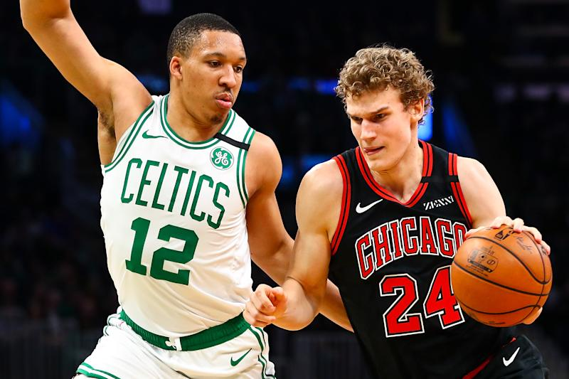 BOSTON, MA - JANUARY 13: Lauri Markkanen #24 of the Chicago Bulls drives to the basket while guarded by Grant Williams #12 of the Boston Celtics during a game at TD Garden on January 13, 2019 in Boston, Massachusetts. NOTE TO USER: User expressly acknowledges and agrees that, by downloading and or using this photograph, User is consenting to the terms and conditions of the Getty Images License Agreement. (Photo by Adam Glanzman/Getty Images)
