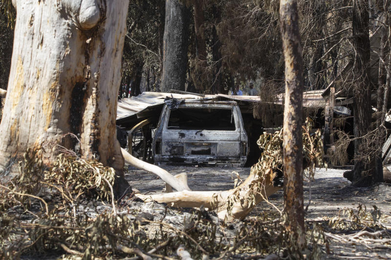 "Damage caused by bushfire is seen at resident Brian Williams' resort at Lake Cooroibah Road in Noosa Shire, Queensland, Australia, Monday, Nov. 11, 2019. Australia's most populous state New South Wales declared a state of emergency on Monday due to unprecedented wildfire danger as calls grew for Australia to take more action to plan for an counter climate change. New South Wales state Emergency Services Minister David Elliott said residents were facing what ""could be the most dangerous bushfire week this nation has ever seen."" (Rob Maccoll/AAP Images)"
