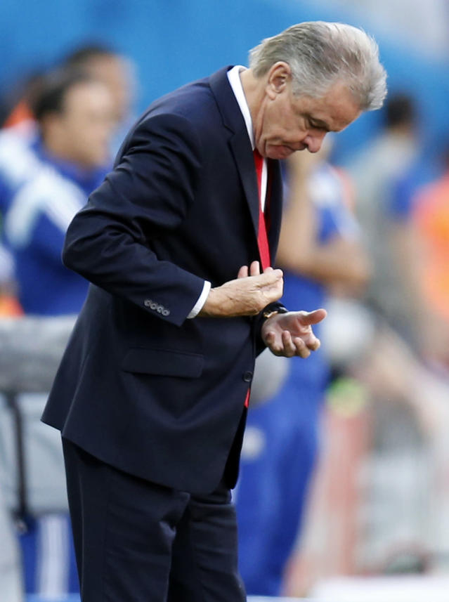Switzerland's coach Ottmar Hitzfeld looks down during the World Cup round of 16 soccer match between Argentina and Switzerland at the Itaquerao Stadium in Sao Paulo, Brazil, Tuesday, July 1, 2014. (AP Photo/Frank Augstein)