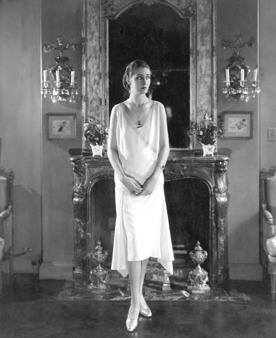 <p>Hemlines had been slowly creeping higher for years, but the Roaring '20s and flapper craze blew the trend up. Not only was the drop waist introduced, but dresses were cut off right below the knee, and sleeveless gowns were no longer scandalous. </p>