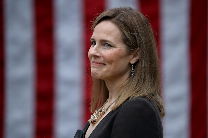 Judge Amy Coney Barrett looks on while being introduced by President Donald Trump as his nominee to the Supreme Court during an event in the Rose Garden at the White House in Washington, Sept. 26, 2020.
