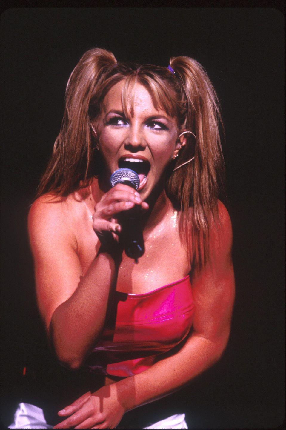 <p>Only one month later, thanks to what I can only assume are a few pounds of extensions, Britney was seen in concert with honey brown hair and high pigtails, naturally.</p>