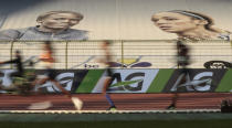 Runners pass the stands during the One Hour Women at the Diamond League Memorial Van Damme athletics event at the King Baudouin stadium in Brussels on Friday, Sept. 4, 2020. (AP Photo/Virginia Mayo)