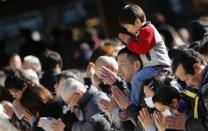 People offer prayers on the first day of the new year at Meiji Shrine in Tokyo January 1, 2014. REUTERS/Yuya Shino