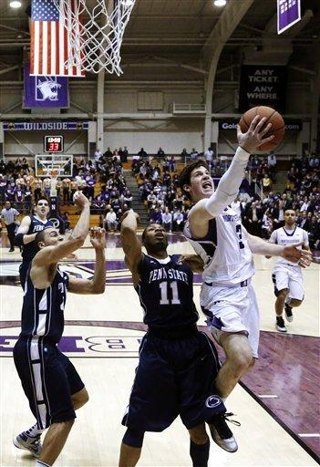 Northwestern guard Dave Sobolewski (3) shoots and scores past Penn State's Ross Travis and Jermaine Marshall (11) during the first half of an NCAA college basketball game, Thursday, March 7, 2013, in Evanston, Ill. (AP Photo/Charles Rex Arbogast)