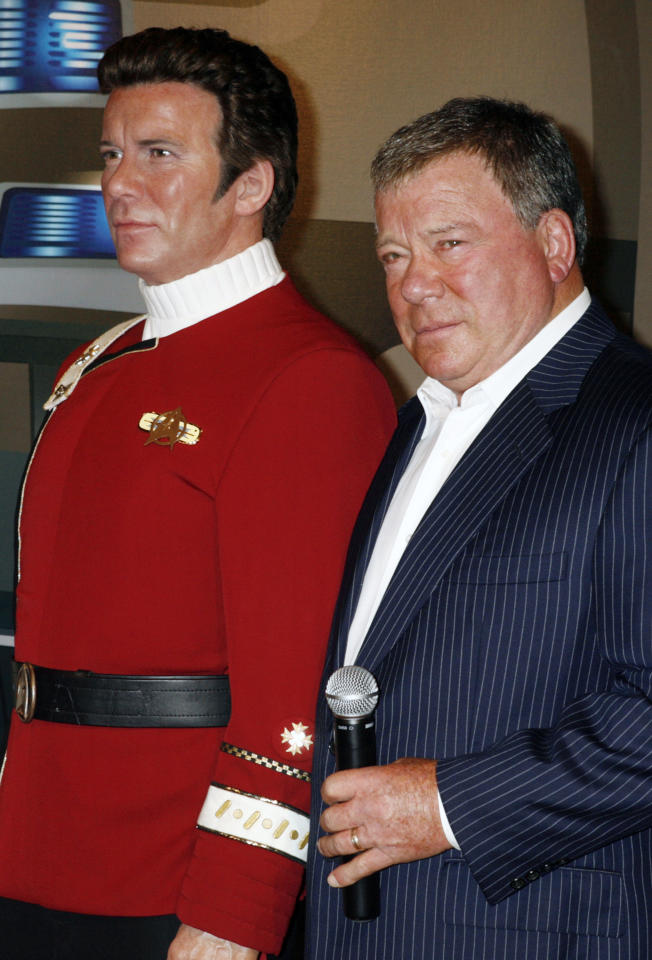 "Canadian actor William Shatner (R) poses as he unveils a wax figure of himself as character Captain James T. Kirk from the ""Star Trek"" television series at Madame Tussauds Hollywood November 4, 2009.  REUTERS/Fred Prouser"