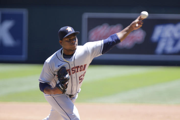 Houston Astros Framber Valdez throws against the Minnesota Twins in the first inning of a baseball game, Sunday, June 13, 2021, in Minneapolis. (AP Photo/Andy Clayton-King)