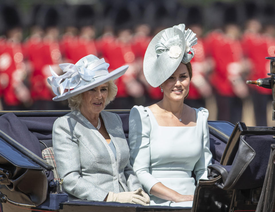 <p>The Duchess of Cambridge wears a icy blue Alexander McQueen dress with a decorative Juliette Botterill hat, while the Duchess of Cornwall matches in a pale blue silk dress and coat by Bruce Oldfield and a hat by Philip Treacy.<br><em>[Photo: Getty]</em> </p>