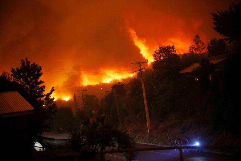 Chile's worst wildfires destroy town, death toll at 10