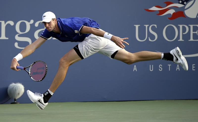 John Isner chases down a ball to return to Philipp Kohlschreiber, of Germany, during the third round of the 2013 U.S. Open tennis tournament, Saturday, Aug. 31, 2013, in New York. (AP Photo/Darron Cummings)