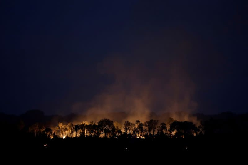 A tract of the Amazon jungle is seen burning as it is cleared by loggers and farmers near Humaita
