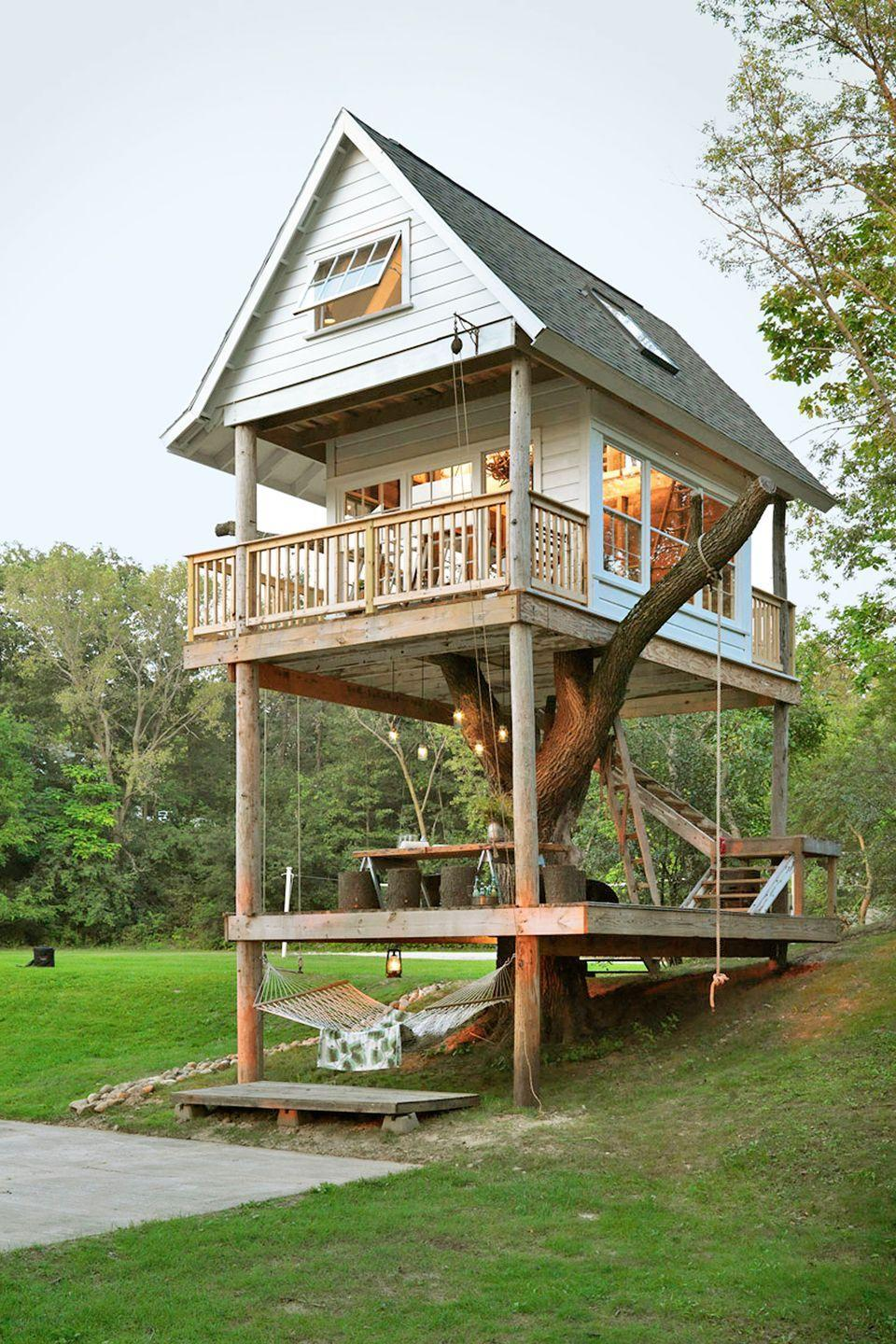 """<p>With its <a href=""""https://www.countryliving.com/outdoor/outdoor-living/adult-summer-camps#category1-1"""" rel=""""nofollow noopener"""" target=""""_blank"""" data-ylk=""""slk:1920s cabins"""" class=""""link rapid-noclick-resp"""">1920s cabins</a> and vintage Boy Scout tents, <a href=""""http://www.wandawega.com/"""" rel=""""nofollow noopener"""" target=""""_blank"""" data-ylk=""""slk:Camp Wandawega"""" class=""""link rapid-noclick-resp"""">Camp Wandawega</a>, located in Elkhorn, Wisconsin, evokes the set of Wes Anderson's <em>Moonrise Kingdom. </em>But the camp's most charming feature is its three-level treehouse, built around a massive elm tree and outfitted with Pendleton blankets, tree swings, and Mason jar light fixtures. Used as a common space, guests can read a book in the treehouse's library on a rainy day or spend a lazy afternoon on the bottom-level hammock. </p><p><a class=""""link rapid-noclick-resp"""" href=""""http://www.wandawega.com/tour/treehouse/"""" rel=""""nofollow noopener"""" target=""""_blank"""" data-ylk=""""slk:SEE INSIDE"""">SEE INSIDE</a></p>"""