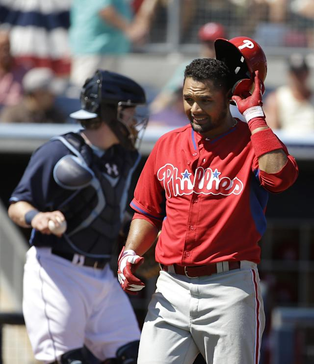 Philadelphia Phillies' Andres Blanco steps away from the batters box after the bat slipped out of his hands on a swing as Tampa Bay Rays catcher Ryan Hanigan, left, looks on in the first inning an exhibition baseball game, Monday, March 3, 2014, in Port Charlotte, Fla. (AP Photo/Steven Senne)