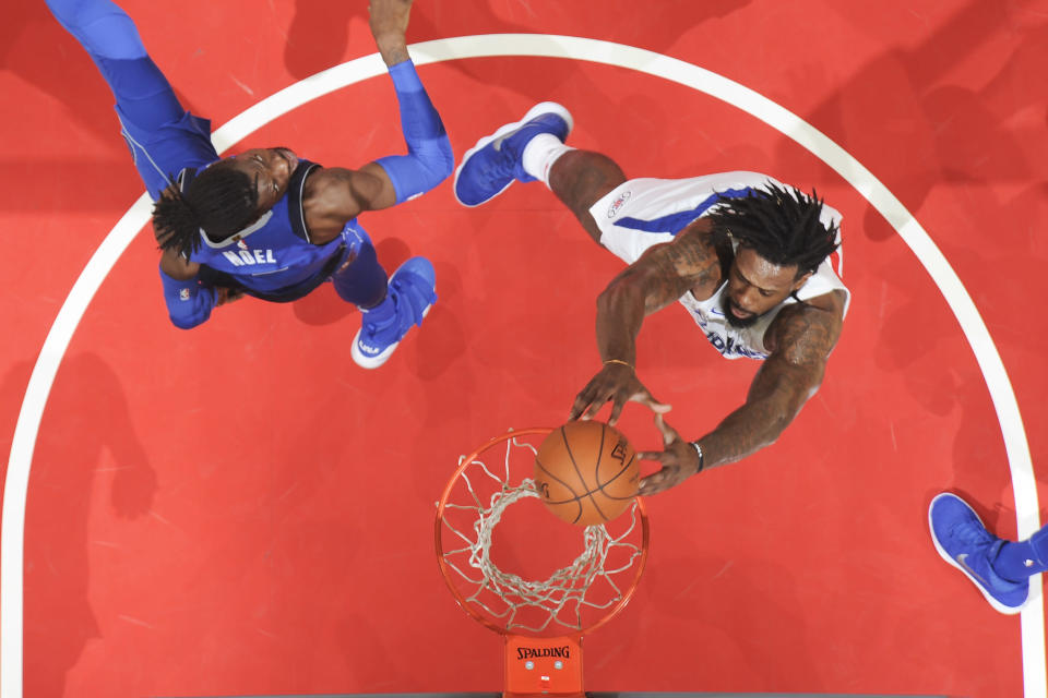 The next time DeAndre Jordan goes above the rim to throw it down, he'll be wearing a Dallas Mavericks uniform. (Getty)