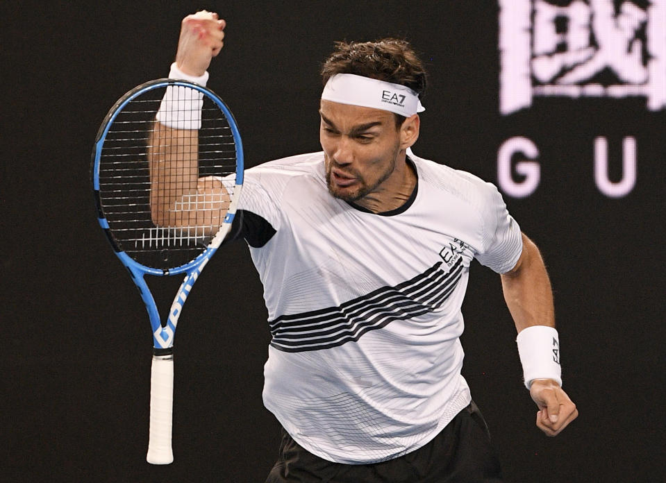 Italy's Fabio Fognini punches his racket in frustration during his second round match against Australia's Jordan Thompson at the Australian Open tennis championship in Melbourne, Australia, Wednesday, Jan. 22, 2020. (AP Photo/Andy Brownbill)