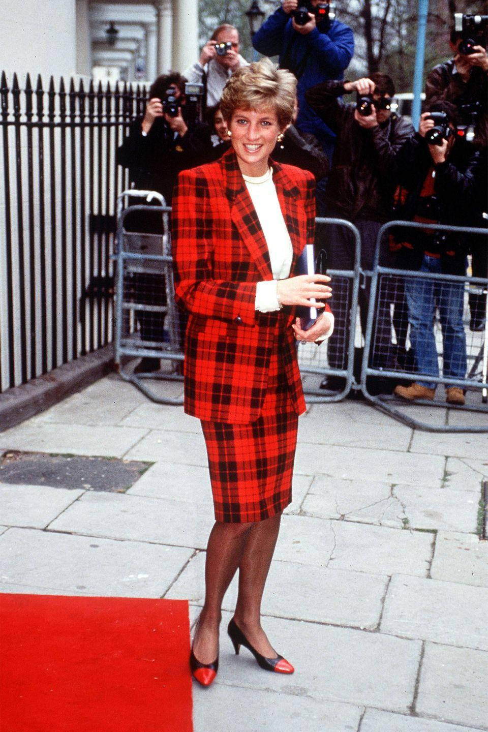 <p>In a checkered red and black suit out in London. </p>