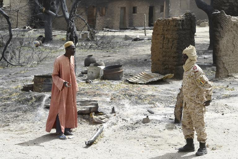 A man speaks to a Chadian soldier in the town of Malam Fatori in northeast Nigeria on April 3, 2015, after it was was retaken from Boko Haram by troops from Chad and Nigeria