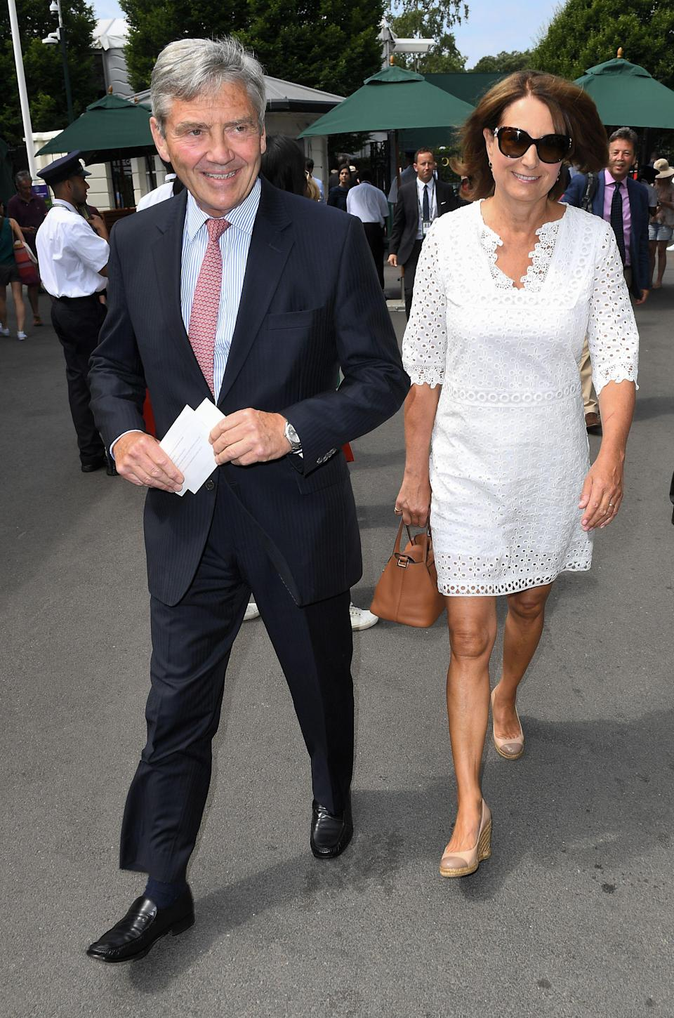 <p>The Duchess of Cambridge's parents, Carole and Michael Middleton, are also self-confessed fans of tennis. So it was no surprise to the couple don their finest clobber for day three of Wimbledon 2018. Cue the royals! <em>[Photo: Rex]</em> </p>