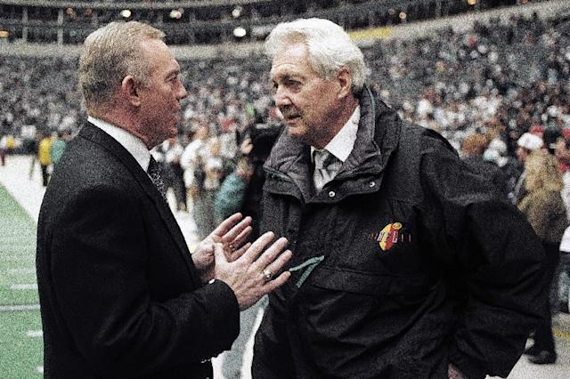 FILE - In this Jan. 23, 1994, file photo, Dallas Cowboys owner Jerry Jones, left, talks with CBS commentator Pat Summerall before the NFL football NFC championship game between the Cowboys and the San Francisco 49ers in Irving, Texas. Fox Sports spokesman Dan Bell said Tuesday, April 16, 2013, that Summerall, the NFL player-turned-broadcaster whose deep, resonant voice called games for more than 40 years, has died at the age of 82. (AP Photo/Ron Heflin, File)