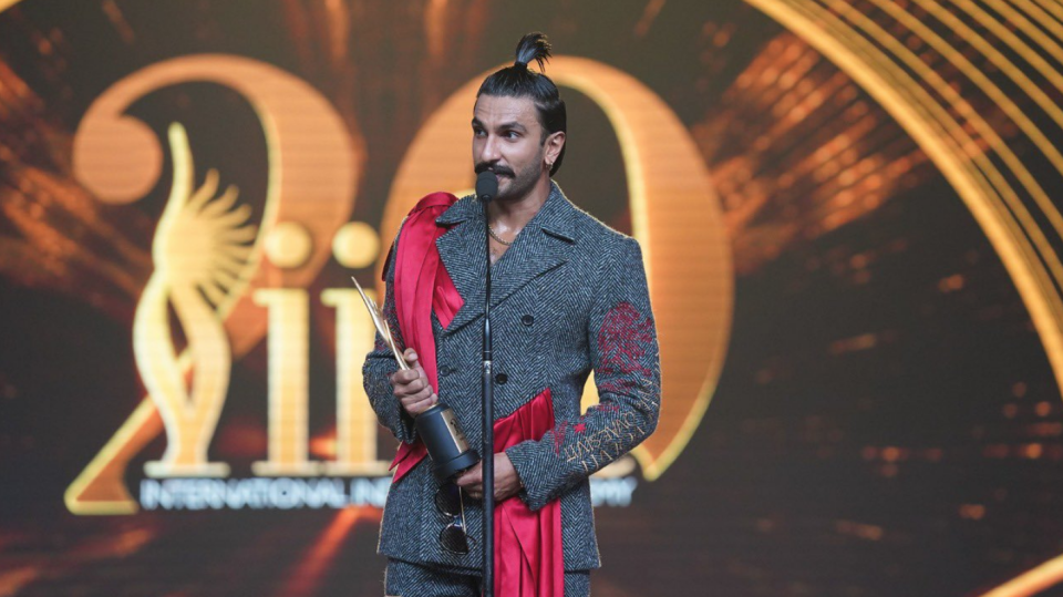 Ranveer Singh with his award for <i>Padmaavat</i>.