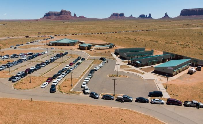 "<span class=""caption"">Residents of the Navajo Nation in Monument Valley, Arizona, line up to collect water and supplies as COVID-19 spreads through the area. Approximately one-third of this sovereign territory's 178,000 residents don't have access to running water or sanitation.</span> <span class=""attribution""><a class=""link rapid-noclick-resp"" href=""https://www.gettyimages.com/detail/news-photo/navajo-indians-line-up-in-their-vehicles-to-collect-water-news-photo/1215970681?adppopup=true"" rel=""nofollow noopener"" target=""_blank"" data-ylk=""slk:Getty Images / Mark Ralston"">Getty Images / Mark Ralston</a></span>"