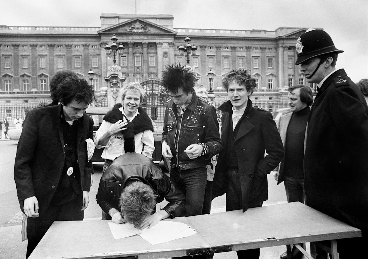 File photo dated 10/03/77 of the Sex Pistols, signing a new recording contract with A&M Records outside Buckingham Palace in London. (left to right) Johnny Rotten, Steve Jones, Paul Cook, Sid Vicious and the group's manager Malcolm McLaren. A legal fight between two former Sex Pistols band members and frontman Johnny Rotten over the use of their songs in a television series has begun at the High Court in London. Issue date: Friday July 16, 2021.