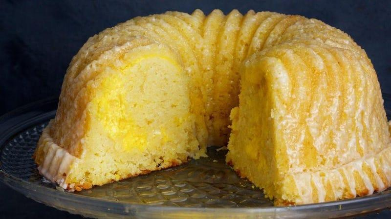 Frosted bundt cake on cake stand