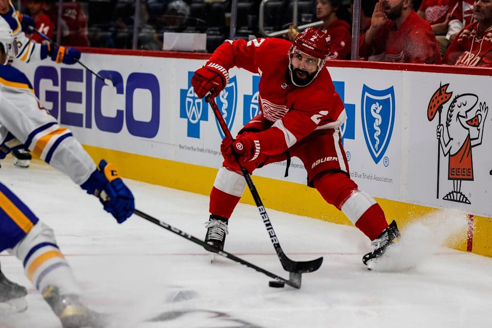 Detroit Red Wings defenseman Nick Leddy (2) protects the puck against the Buffalo Sabres left wing Brendan Warren (42) during the second period of a preseason game at Little Caesars Arena in Detroit on Thursday, Sept. 30, 2021.