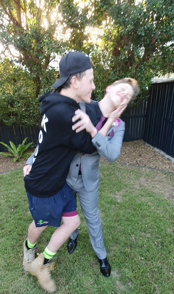Lachy is seen joking around with his brother Mitchell before his school formal. Source: Suplied