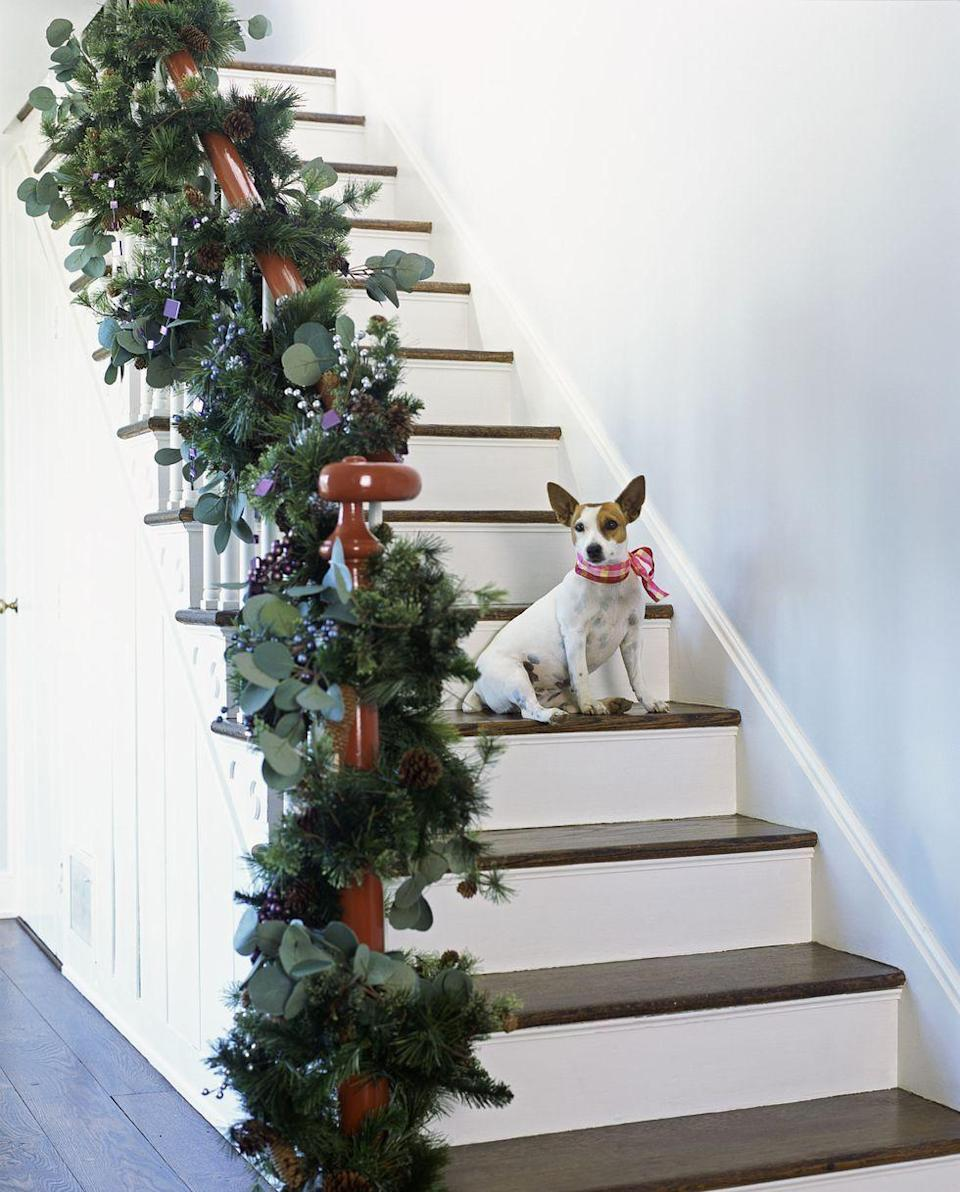 <p>Keep things natural and understated with a forest green garland to complete your earthy holiday look.</p>