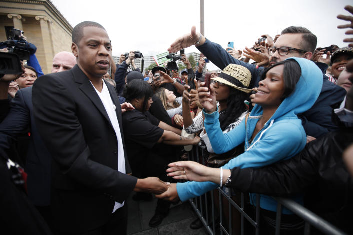 "Entertainer Shawn ""Jay-Z"" Carter meets with fans after a news conference at the Philadelphia Museum of Art, Monday, May 14, 2012, in Philadelphia. The rapper announced plans for a two-day music festival in Philadelphia's at Fairmount Park, featuring nearly 30 acts ""that embody the American spirit"" on Labor Day weekend, Sept. 1 and Sept. 2, 2012. (AP Photo/Matt Rourke)"