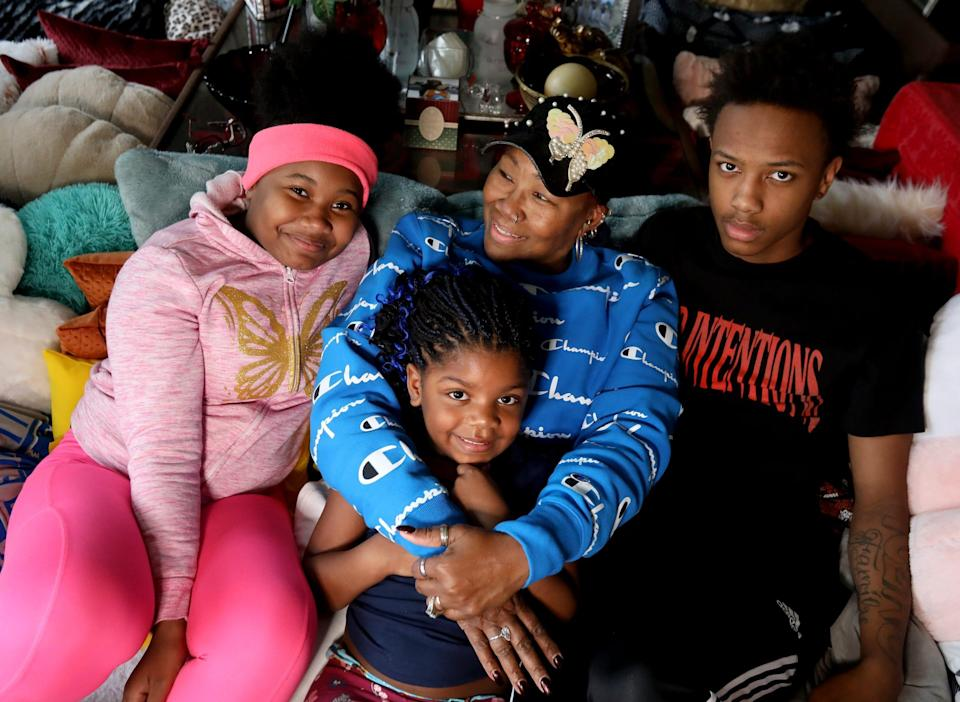 Tonya Williams, 69, of Flint with her grandkids (L to R) Don'jhanaya Buck, 11, Genasis Wilson, 4 and JaTavion Walker, 14 at their home on Tuesday, April 20, 2021.Williams, has been waiting on the refund from her tax return since February and is one of so many affected by the long delays of returns being processed.