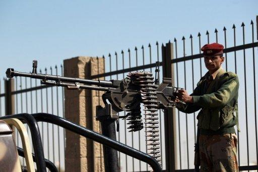 A soldier stands on the top of a military vehicle at a checkpoint on March 16, 2013 in the Yemeni capital Sanaa