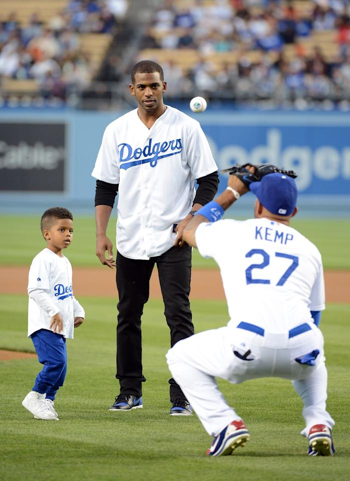 LOS ANGELES, CA - APRIL 02:  Chris Paul #3 of the Los Angeles Clippers and his son Chris Paul Jr. participate in a ceremonial first pitch with Matt Kemp #27 of the Los Angeles Dodgers before the game against the San Francisco Giants at Dodger Stadium on April 2, 2013 in Los Angeles, California.  (Photo by Harry How/Getty Images)