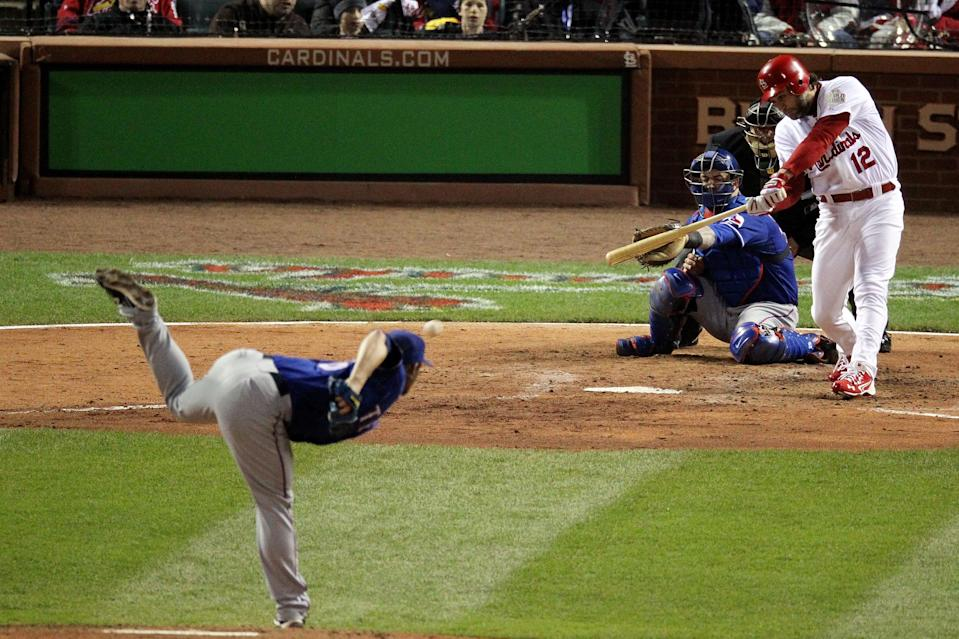 ST LOUIS, MO - OCTOBER 19: Lance Berkman #12 of the St. Louis Cardinals hits a two-RBI single in the bottom of the fourth inning against C.J. Wilson #36 of the Texas Rangers during Game One of the MLB World Series at Busch Stadium on October 19, 2011 in St Louis, Missouri. (Photo by Jamie Squire/Getty Images)