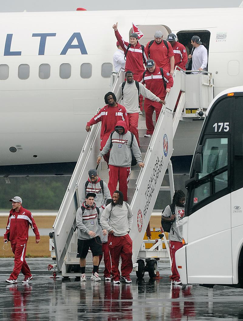 The Alabama football team arrives at Tuscaloosa Regional Airport  in Tuscaloosa, Ala., Tuesday, Jan. 10 10, 2012. Alabama blew out LSU 21-0 in the BCS championship game Monday night, and headed back to Tuscaloosa with it's second national championship in three years. (AP Photo/The Birmingham News, Tamika Moore) MAGS OUT