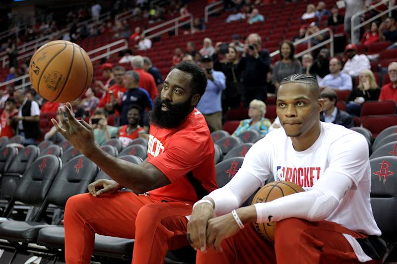 Oct 16, 2019; Houston, TX, USA; Houston Rockets guards James Harden (13, left) and Russell Westbrook (0) during pregame warmups prior to the game against the San Antonio Spurs at Toyota Center. Mandatory Credit: Erik Williams-USA TODAY Sports