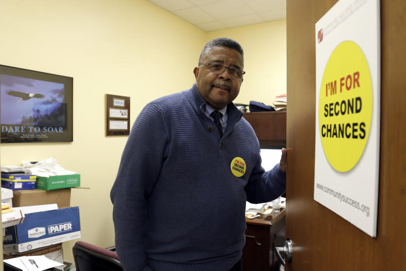 In this photo taken Wednesday, Dec. 18, 2019 Dennis Gaddy, the co-founder of the Raleigh-based Community Success Initiative, is shown at the door to his office in Raleigh, N.C. Gaddy, 62, served time behind bars and said he was unable to vote for seven years after being released from prison because he was on probation. (AP Photo/Gerry Broome)