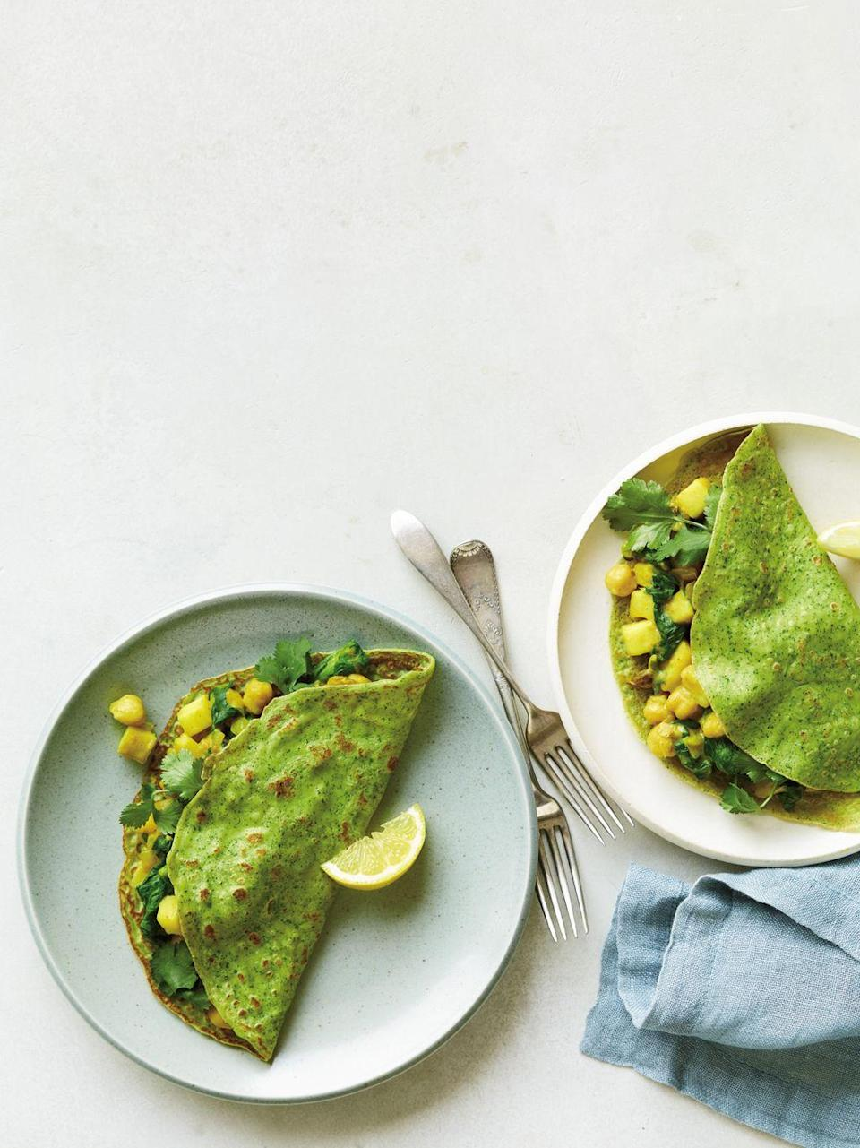 """<p>For a savory take on the French favorite, combine Mediterranean staples like chickpeas, eggs, and lemons with bright cilantro and spicy curry. It's just about the perfect brunch.</p><p><a href=""""https://www.prevention.com/food-nutrition/recipes/a20501447/spinach-curry-crepes-with-apple-raisins-and-chickpeas/"""" rel=""""nofollow noopener"""" target=""""_blank"""" data-ylk=""""slk:Get the recipe from Prevention »"""" class=""""link rapid-noclick-resp""""><strong><em>Get the recipe from Prevention »</em></strong></a></p>"""