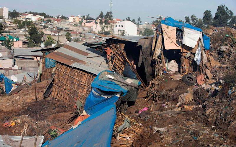 Damaged dwellings after a landslide in the main city dump of Addis Ababa - Credit: AFP