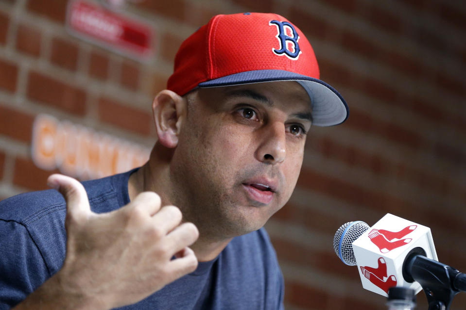 FILE— In this Sept. 9, 2019, file photo, Boston Red Sox manager Alex Cora talks during a news conference before the team's baseball game against the New York Yankees in Boston. The Boston Red Sox were stripped of their second-round pick in this year's amateur draft by Major League Baseball for breaking video rules in 2018 and former manager Alex Cora was suspended through the 2020 postseason for his previous conduct as bench coach with the Houston Astros. Baseball Commissioner Rob Manfred announced his decision Wednesday, April 22, 2020, concluding Red Sox replay system operator J.T. Watkins used in-game video to revise sign sequences provided to players. Watkins was suspended without pay through this year's postseason and prohibited from serving as the replay room operator through the 2021. (AP Photo/Michael Dwyer, File)