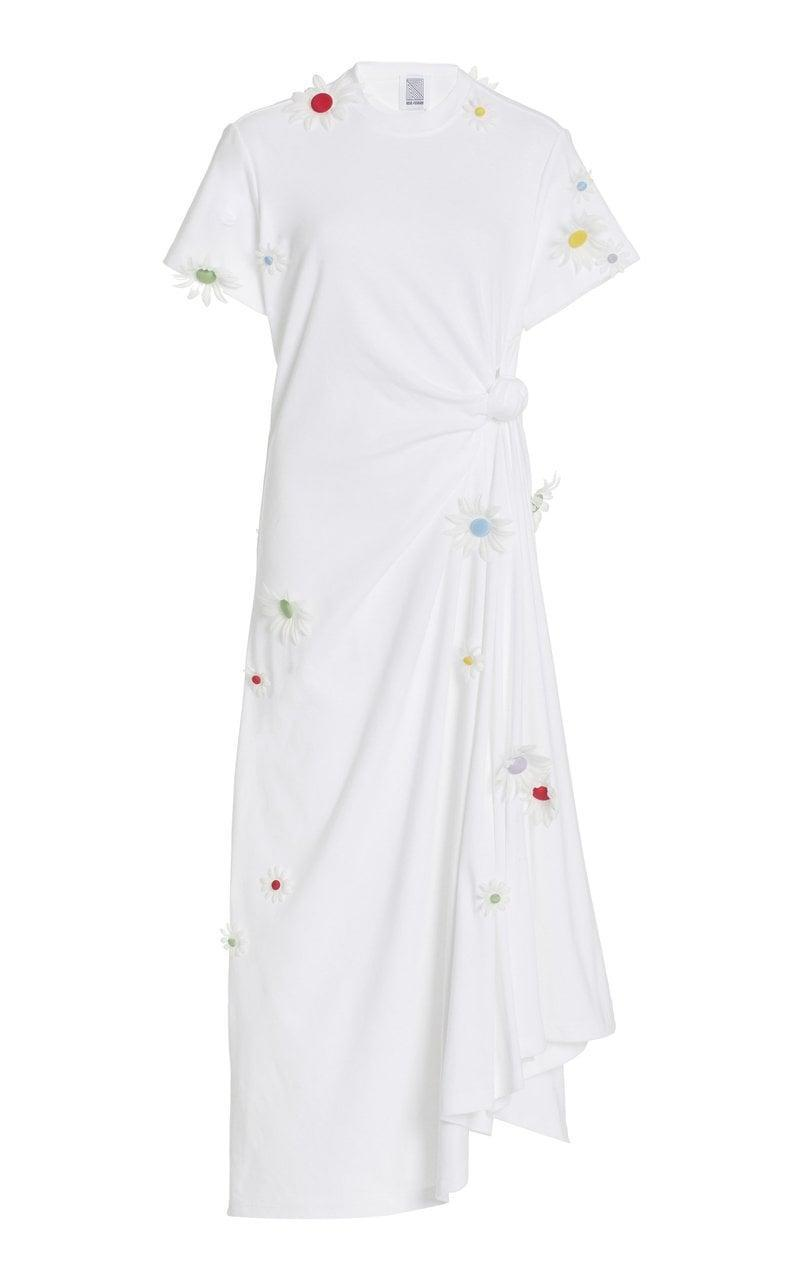"""<p>""""I'm all about an easygoing dress that emits positive energy. I'd wear this <span>Rosie Assoulin Knotted Tee Dress</span> ($995), an exclusive for Moda Operandi covered in daisies, at home right now, and then with my high-tops when it gets warmer."""" </p>"""