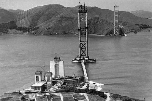 The construction of the Golden Gate Bridge, which will link Fort Point, bottom, with Marin County, Calif., top, is seen as work progressed, 1934. (AP Photo/Redwood Empire Association)