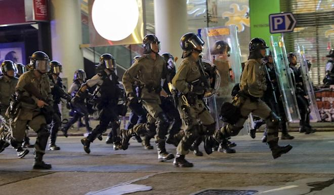 Anti-riot officers in Sham Shui Po during one of the many protests that have flared up citywide. Photo: Edmond So