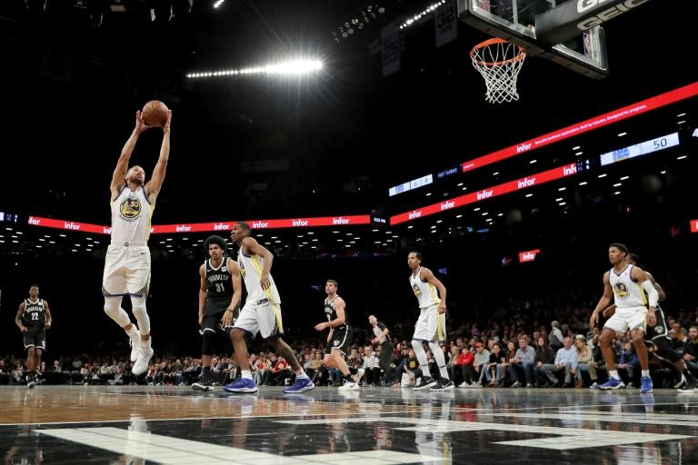 Stephen Curry of the Golden State Warriors staels a pass against the Brooklyn Nets at Barclays Center