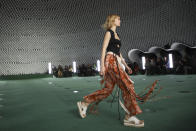 A model wears a creation for the Stella McCartney Spring-Summer 2022 ready-to-wear fashion show presented in Paris, Monday, Oct. 4, 2021. (Photo by Vianney Le Caer/Invision/AP)