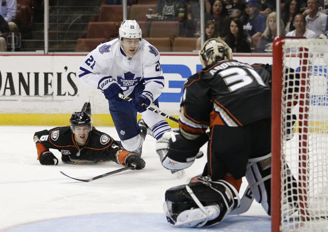 Toronto Maple Leafs' James van Riemsdyk, center, tries to score against Anaheim Ducks goalie Frederik Andersen, of Denmark, as he is defended by Anaheim Ducks' Ben Lovejoy, left, during the first period of an NHL hockey game on Monday, March 10, 2014, in Anaheim, Calif. (AP Photo/Jae C. Hong)